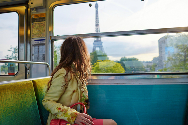 Girl traveling on train in europe