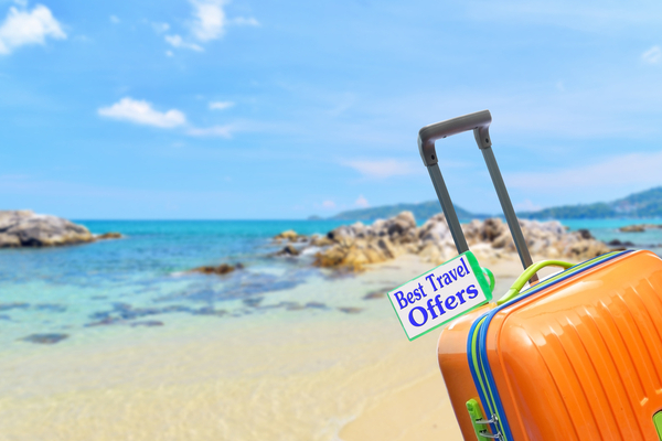 best travel offers suitcase at beach